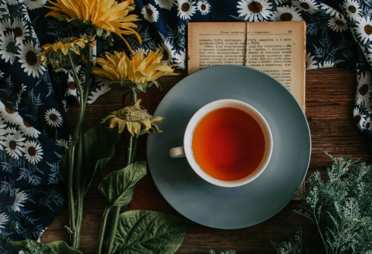 Black Tea and a Book on a Table